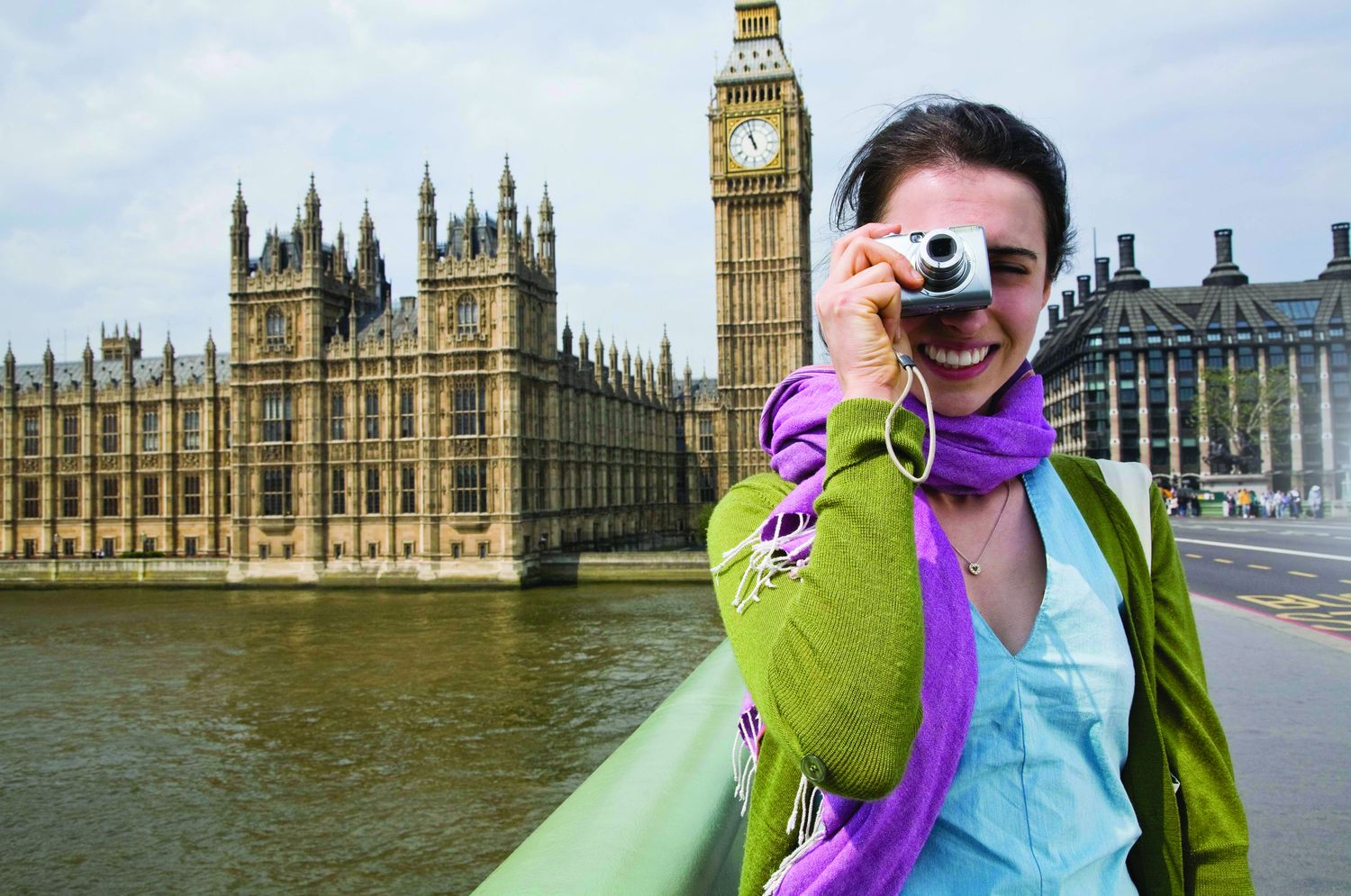 Tourist with digital camera by Big Ben, London, England